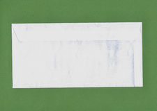 Envelope over green background Royalty Free Stock Photography