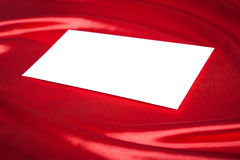 Envelope over red silk background Stock Images