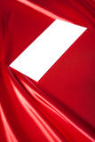 Envelope over red silk background Royalty Free Stock Photos
