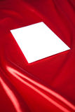 Envelope over red silk background Royalty Free Stock Photo