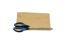 Envelope with A Pair of Scissors on white background Royalty Free Stock Photography