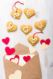 Envelope with paper hearts and cookies. Valentines day backgroun Royalty Free Stock Images