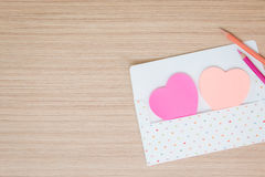 Envelope with paper note heart or post it Stock Photos
