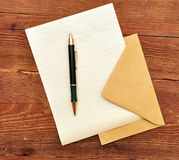 Envelope, paper and pen. Royalty Free Stock Photo