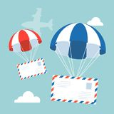 Envelope with parachute in the sky with flying plane and clouds on background. Flat design vector for airmail concept Royalty Free Stock Image