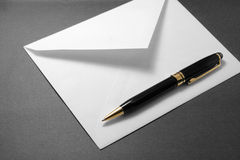 Envelope and pen. Concept of communication Royalty Free Stock Images