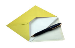 Envelope and pen. Yellow envelope and blue pen Stock Photos