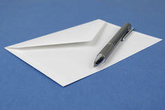 Envelope with pen Stock Photo