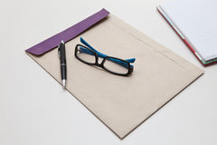 Envelope pen and glasses normal object in working Royalty Free Stock Images