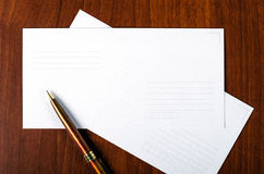 Envelope. With a pen on the table Stock Images