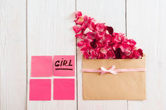 Envelope with petals and pink stickers, free space Stock Image