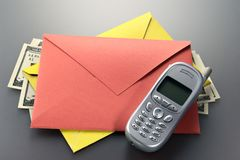 Envelope, phone, dollars Stock Images