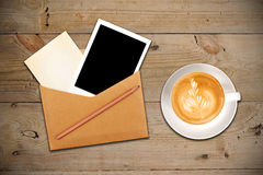 Envelope with photo and coffee Stock Image