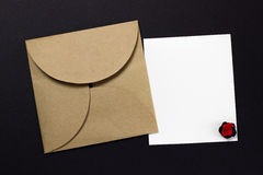 The envelope and a piece of text. On a black background Stock Image