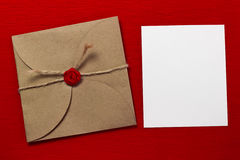 The envelope and a piece of text. On a red background Stock Image