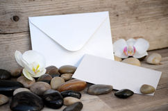Envelope placed on wooden seat Royalty Free Stock Image