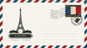 An envelope with a postage stamp with Eiffel tower. An envelope with a postage stamp with the Eiffel tower in Paris, and the flag of France Royalty Free Stock Photos