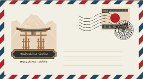 An envelope with a postage stamp with Itsukushima Shrine. And the flag of Japan Stock Photo
