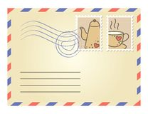 Envelope with postage stamps. Beige envelope with postage stamps on white background Royalty Free Stock Images