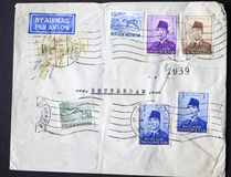 Envelope with postage stamps from Indonesia. 1958 envelope from Indonesia full of postage stamps royalty free stock photography