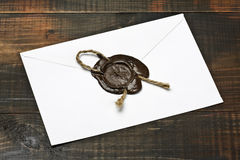 Envelope with the press. Envelope sealed by the sealing wax press stock image