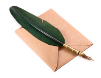 Envelope and quill pen isolated. On white Royalty Free Stock Images