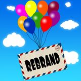 Envelope with REBRAND message attached to multicoloured balloons on blue sky and clouds background. Stock Photos