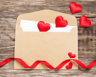 Envelope with red fabric hearts Royalty Free Stock Images