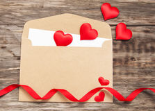 Envelope with red fabric hearts Royalty Free Stock Photos