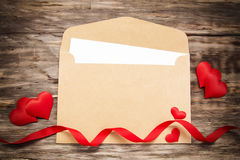 Envelope with red fabric hearts Royalty Free Stock Photography