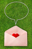 Envelope with red heart and speech bubbles Stock Image