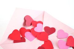Envelope with red hearts Royalty Free Stock Photos