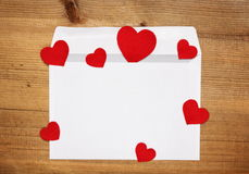Envelope with red hearts Stock Image