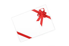 Envelope with red ribbon Stock Images