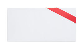 Envelope with red ribbon Royalty Free Stock Photography