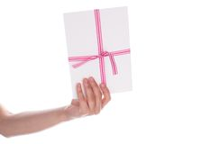 Envelope with a red ribbon in her hand Stock Photo