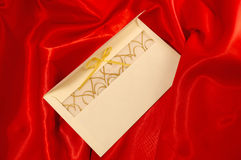 Envelope on the red satin Stock Image
