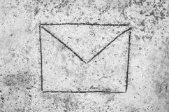 Envelope on sand background Royalty Free Stock Photos
