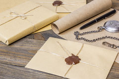 Envelope with sealing wax, ancient scroll. On the table Royalty Free Stock Photo