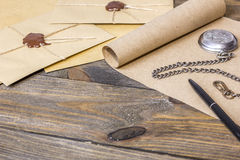 Envelope with sealing wax, ancient scroll. On the table Stock Photo