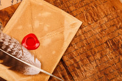 Envelope with sealing wax. Old styled envelope with empty red sealing wax stamp and feather Stock Images