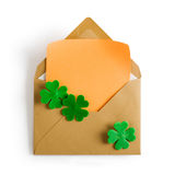Envelope with shamrock and notepad Stock Photography