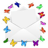 Envelope with the sheet of paper and butterflies Royalty Free Stock Photo