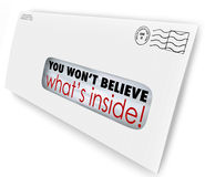 Envelope Special Delivery You Wont Believe Whats Inside. You Won't Believe What's Inside words through the window of an envelope of special offers or news Royalty Free Stock Photo