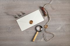 Envelope, stamp, magnifier royalty free stock photography