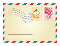 Envelope with stamps. Beige envelope with postage stamps on white background Stock Photography