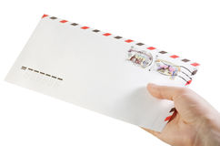 Envelope with stamps in hand Stock Image