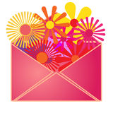An envelope with summer flowers inside. Stock Images