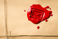 Envelope symbol imprinted in red sealing wax. Close-up on the envelope symbol imprinted in red sealing wax Stock Images