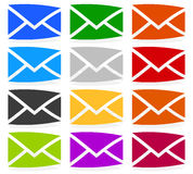 Envelope symbols in 12 colors as contact, support, email icons, Stock Photography